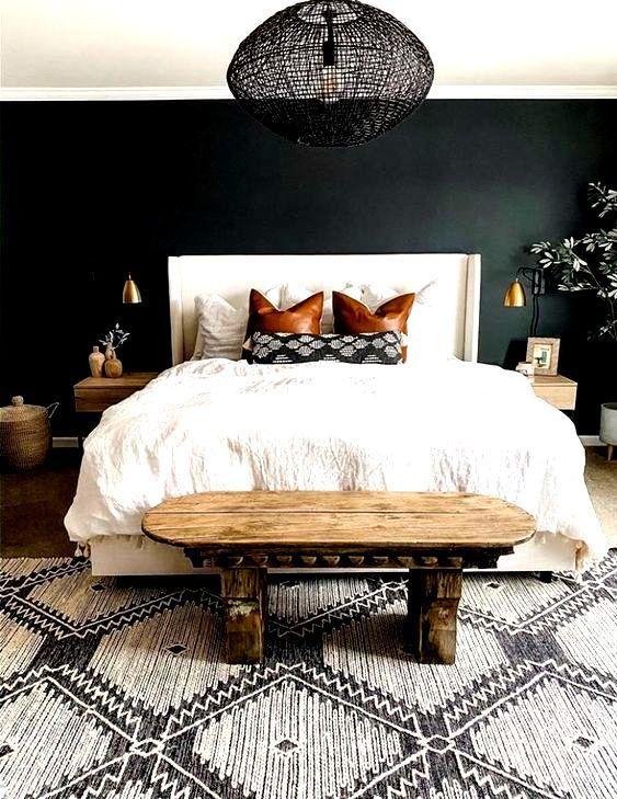 Boho Home Decor A dark green bedroom wall makes an elegant backdrop for the interior the wooden rustic and white bed linens and textured rug gives the room and cozy feeling. Ideal bedroom for a couple. #darkgreenbedroomwalls #cozybedroomideasforcouples #cozybedroomideasforcouplesdark #elegantcozybedroom