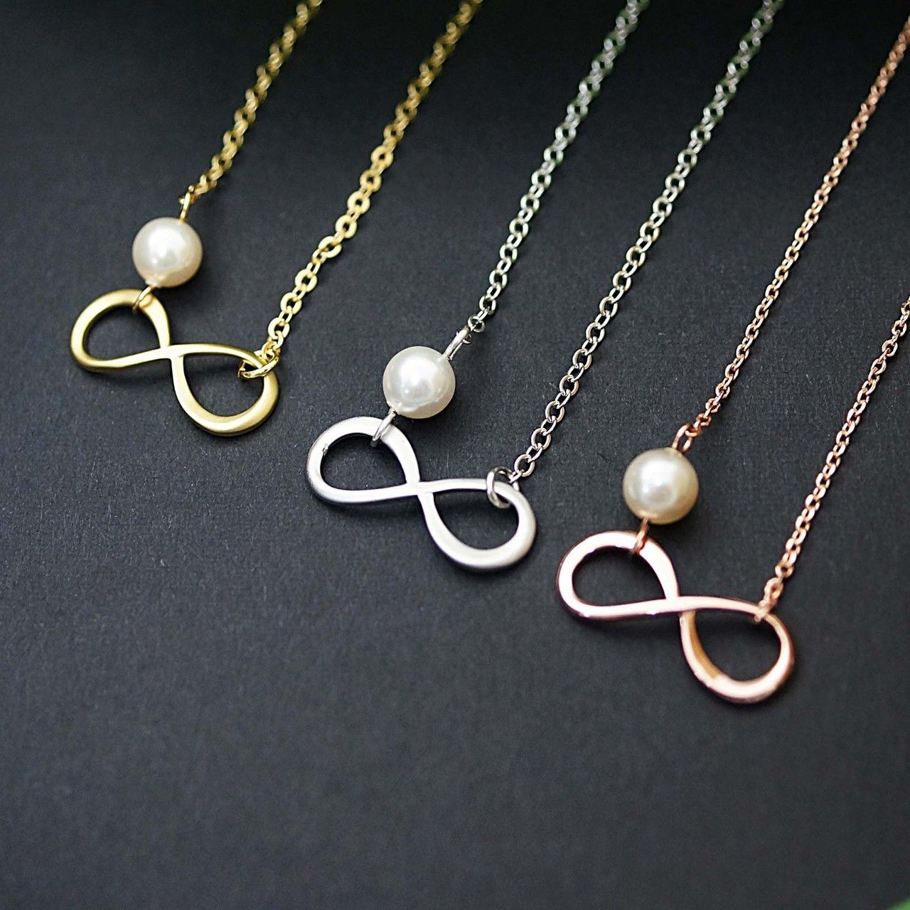 Infinity charm with swarovski pearl necklace