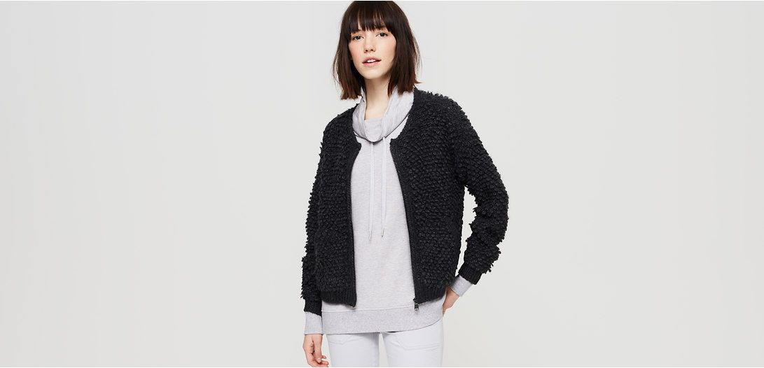 """Our designers likened this boucle beauty to a teddy bear - irresistibly textured, totally adorable and always up for a snuggle. Round neck. Long sleeves. Drop shoulders. Zip front. Welt pockets. 20 1/2"""" long."""