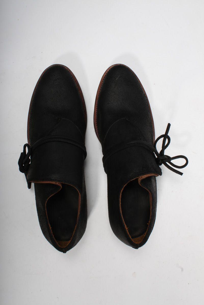 /// Black leather foldover shoe