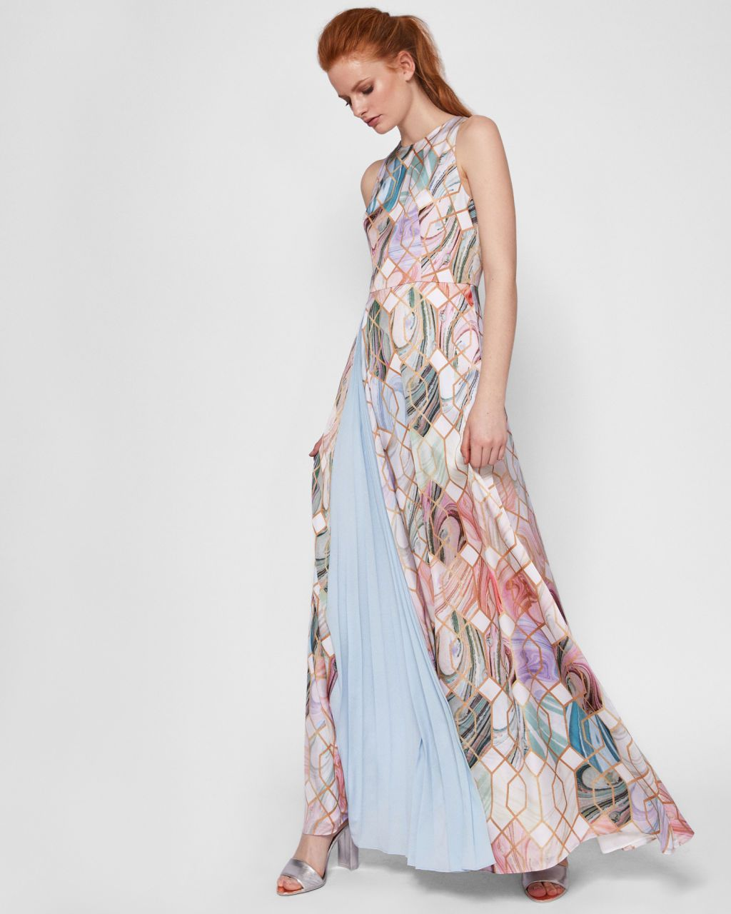 8aaa22a4b2e Make an entrance at your next event in the exquisite BRENNDA maxi dress.  Designed in the opulent Sea of Clouds print