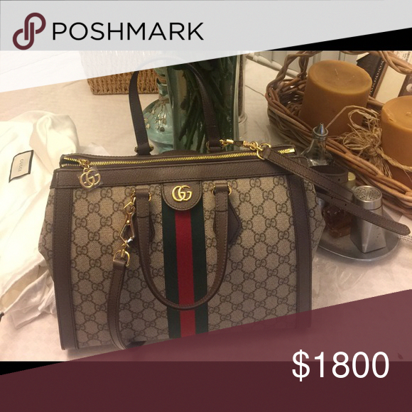 269b937af296 Spotted while shopping on Poshmark: Authentic Gucci Duffle bag with leather  straps! #poshmark #fashion #shopping #style #Gucci #Handbags #Guccihandbags
