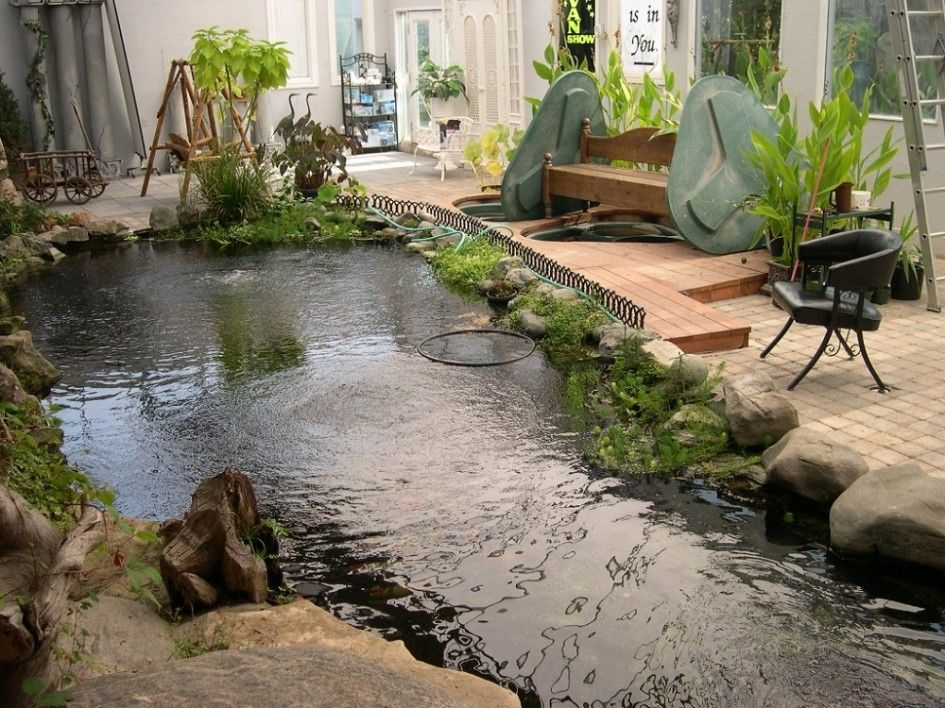 Inspirations modern indoor fish pond design to decoration for Stone koi pond