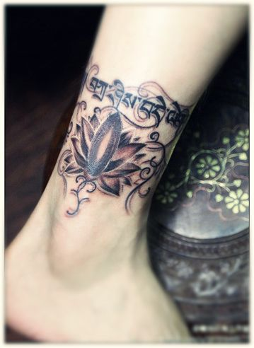 A well designed lotus flower tattoo along with some sanskrit a well designed lotus flower tattoo along with some sanskrit characters mightylinksfo