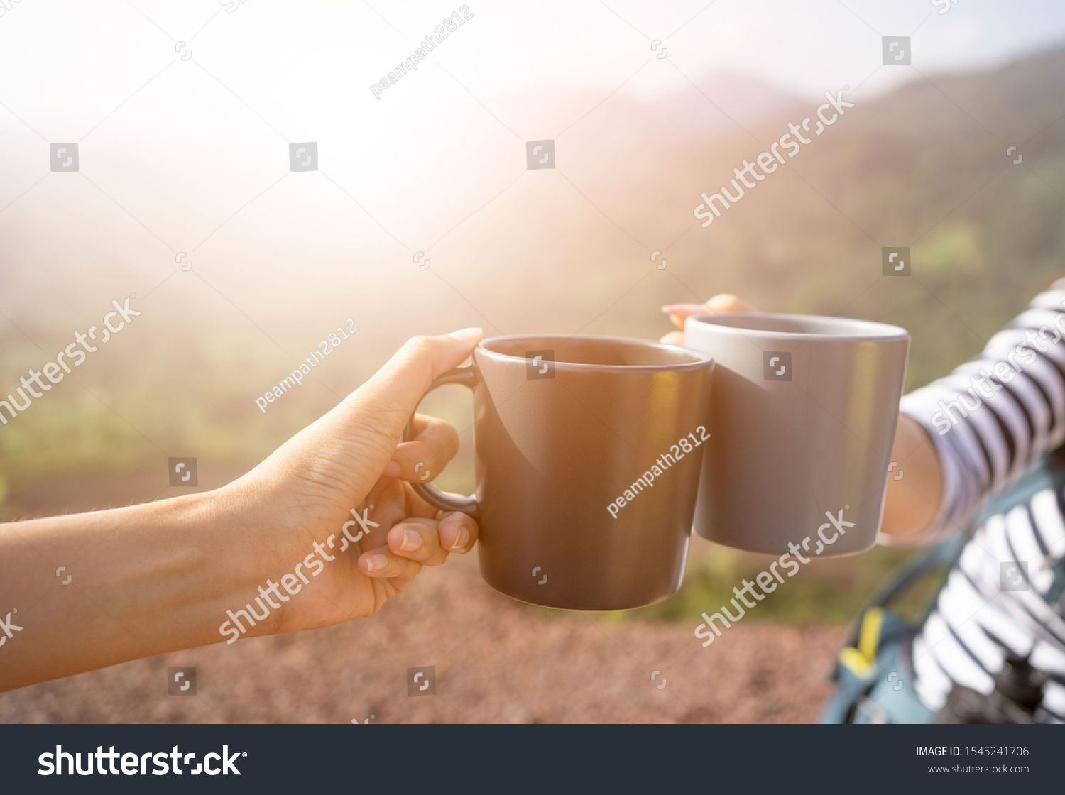 Closeup hands holding coffee cup drinking coffee or tea