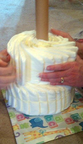 Diaper Cake Without Rolling Diapers Using A Cake Pan For Shaping