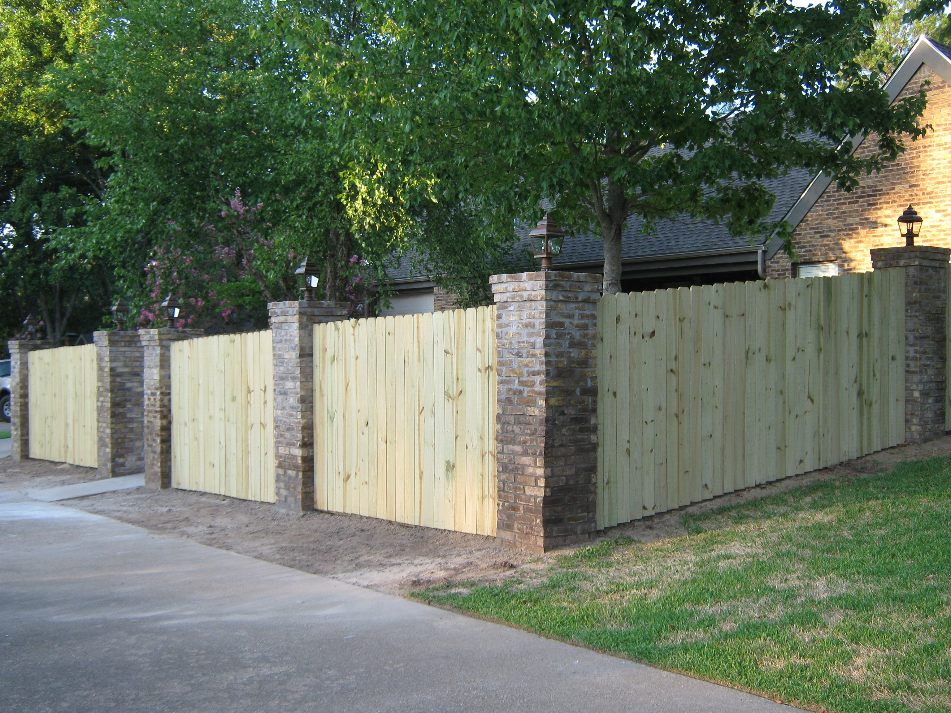 brick and wood fence | Fence design, Fence landscaping