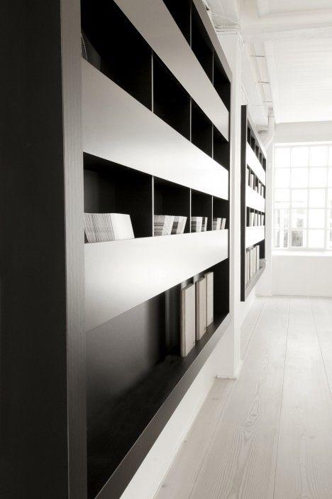 Cabinets in dark wood The Dinesen showroom by Space Copenhagen