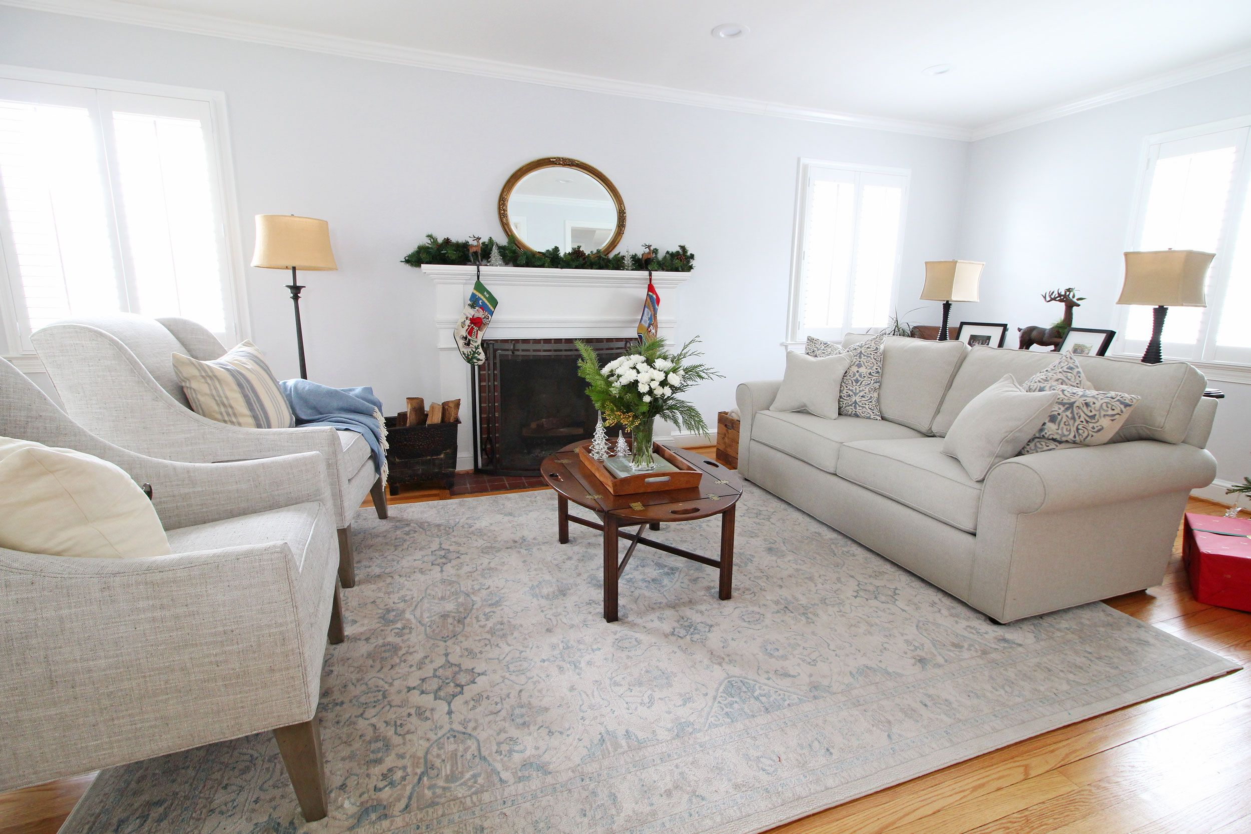 A Transitional Farmhouse Living Room The Blue Cream And Gray Color Scheme Feels Fresh And Clean This Living Room Color Schemes Home Decor Styles Home Decor #transitional #farmhouse #living #room
