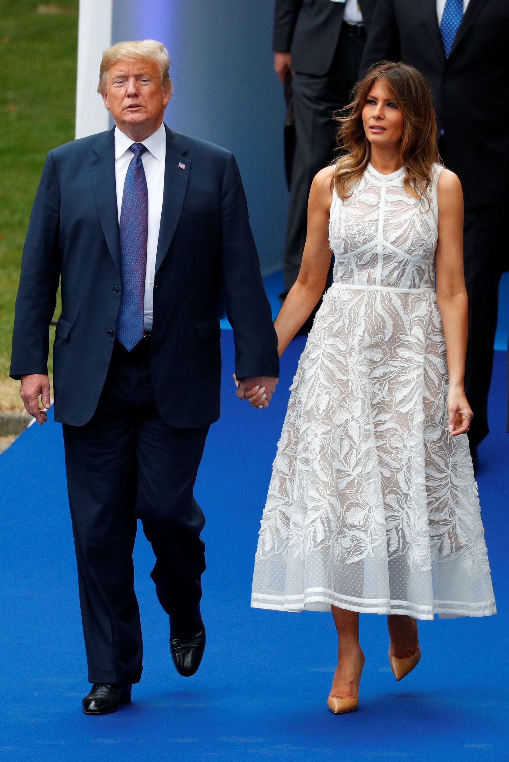 48b44cc563ac U.S. President Donald Trump walks with U.S. first lady Melania Trump in the  Park of the