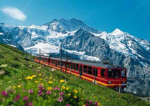 Cog-wheel train ride from Grindelwald to Kleine Scheidegg Switzerland - Swiss Alps