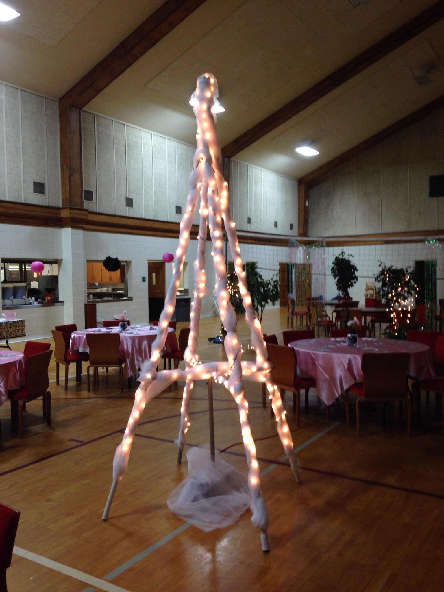 Make an Eiffel Tower out of 4 PVC pipes and duct tape Wrap in white