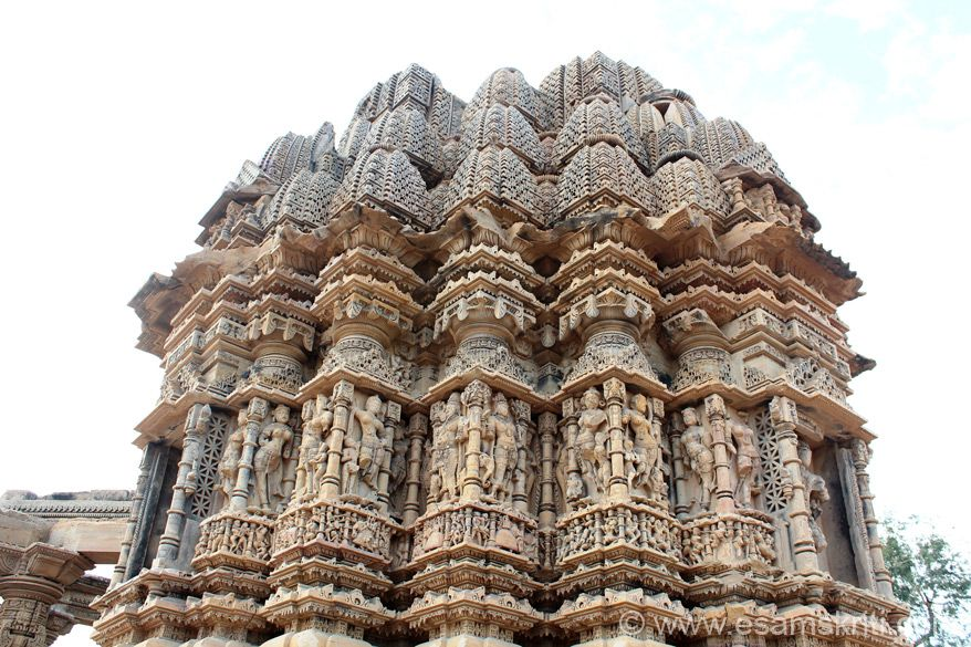A side view of the shikhara, sculptures. Reminds me of temples in Gujarat, Khajuraho, Bhoramdeo Chhattisgarh, Belur and Halebidu in Karnataka. Left of pic see pillar that forms part of the temple.
