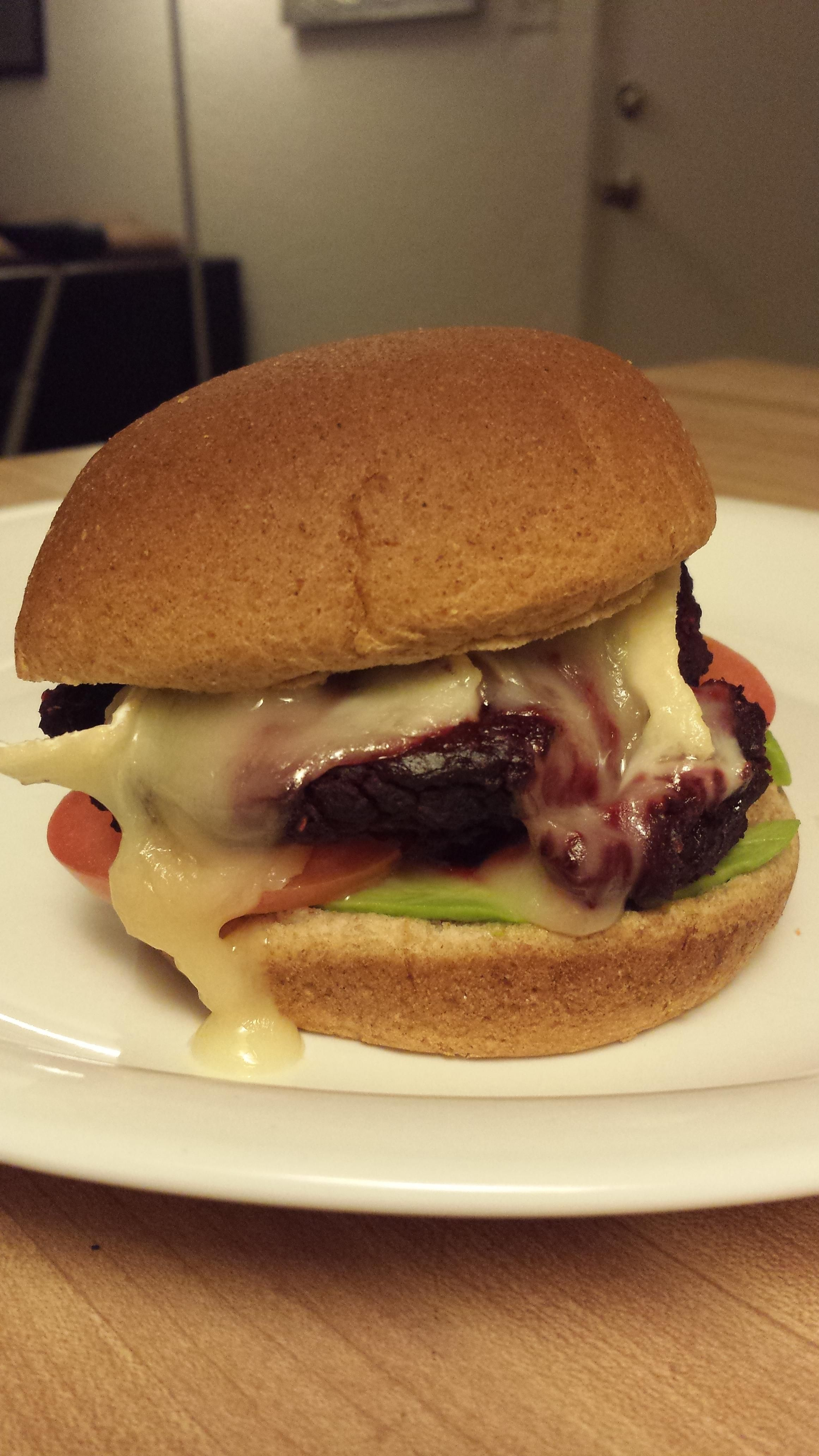 Beet Root Veggie Burger with Avocado Tomato and Melted Brie.