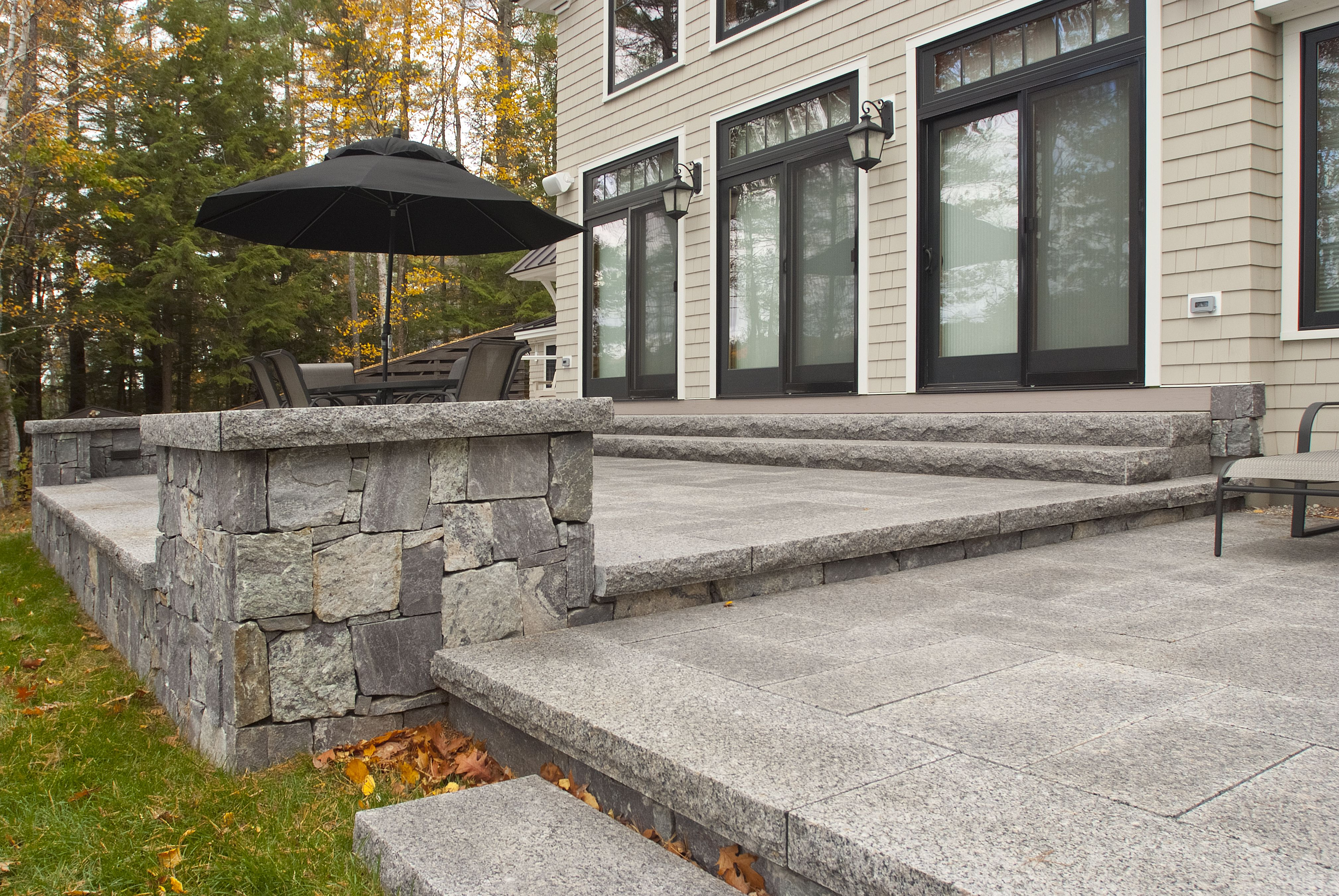 Lake House Living This Private Patio Is Made From Thermal Top Caledonia Granite Pavers Corinthian Granite Square And Rectangle Ven Rustic Patio Patios Patio