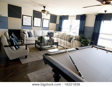 . Stylish modern luxury game room interior design with pool table in