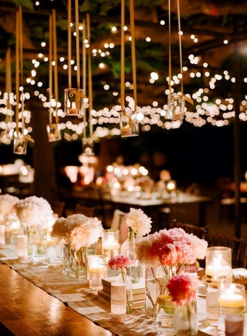 I really like the centerpieces mixed with candles. I know we won't be able to hang the candles but the centerpieces are smaller, simple, but beautiful and romantic!