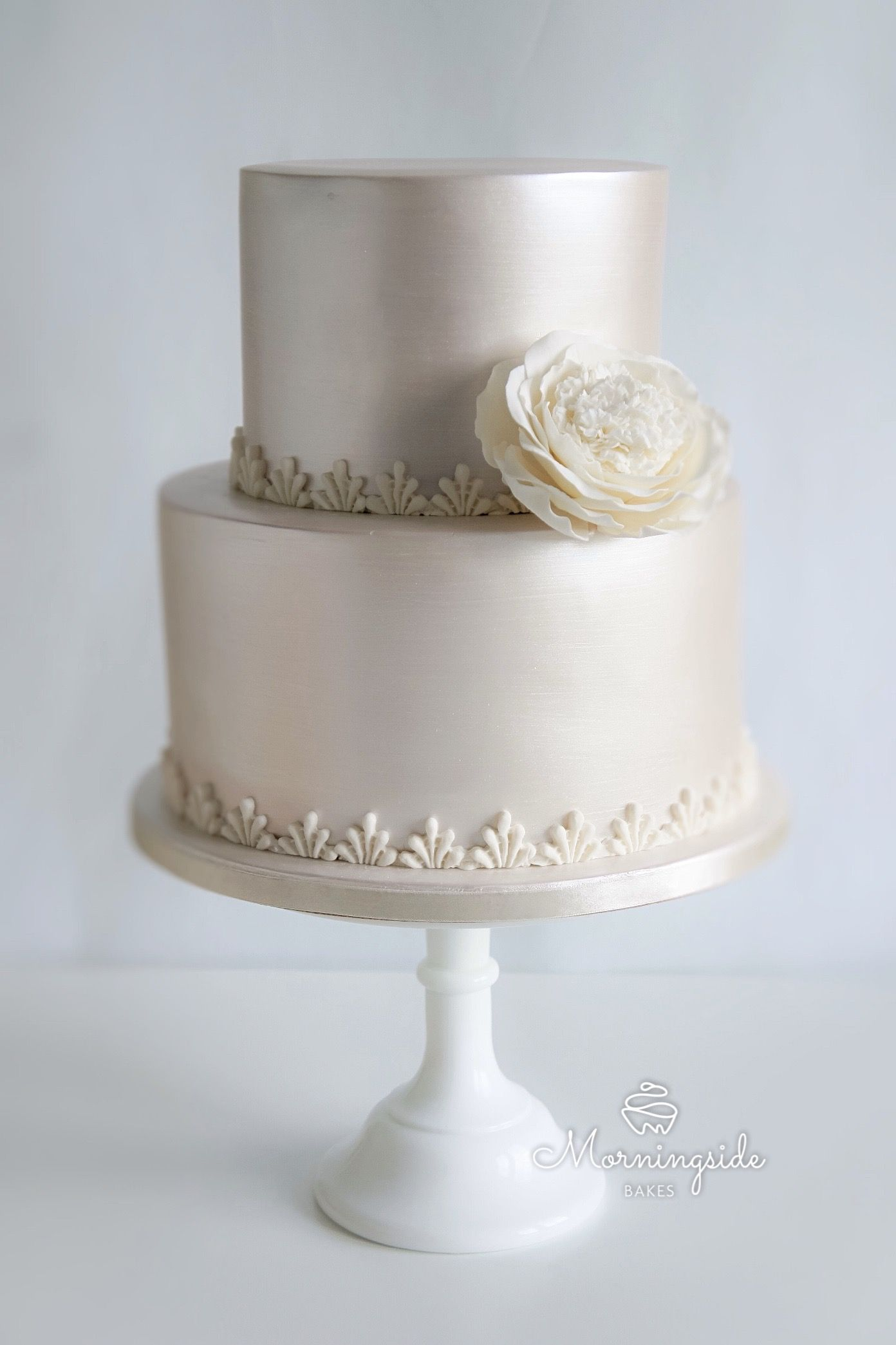 Pearl shimmer lustre wedding cake with large sugar flower