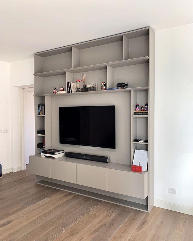 """Photo of FRATELLI BERGO Ⓡ on Instagram: """"Parete attrezzata soggiorno realizzata interamente su misura composta da libreria perimetrale con mobile inferiore sospeso. La modularità…"""""""
