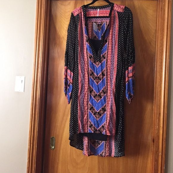 FREE PEOPLE tunic FREE PEOPLE multi colored high low tunic. Comes with attached black slip. Never been worn. Tags on. Looks really cute styled with a belt and boots or more casual unbelted with sandals. Can ever be worn with skinny jeans or leggings. Very versatile. Free People Dresses High Low