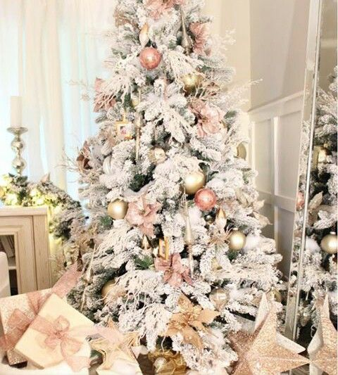 Pink ornaments on a flocked Christmas tree