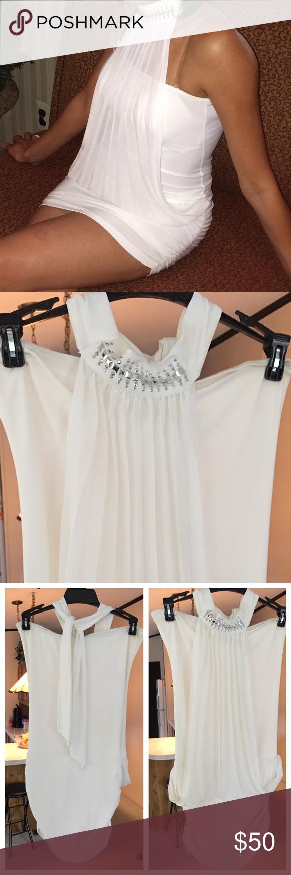 White mini dress Beautiful white halter top mini dress. Collar has silver design. Worn once Dresses Mini