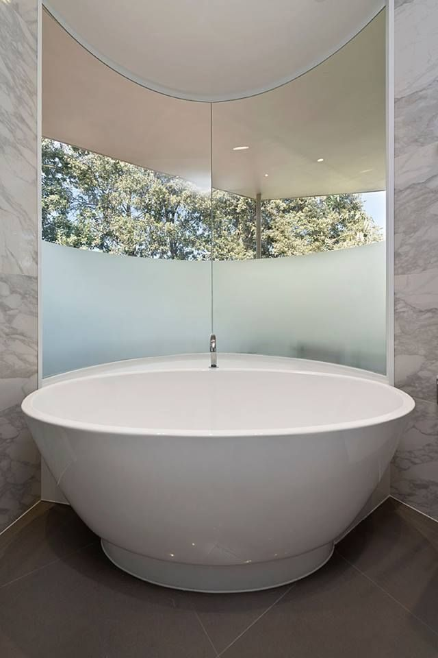 A tub with a view! Soak in a luxurious feestanding tub, surrounded ...