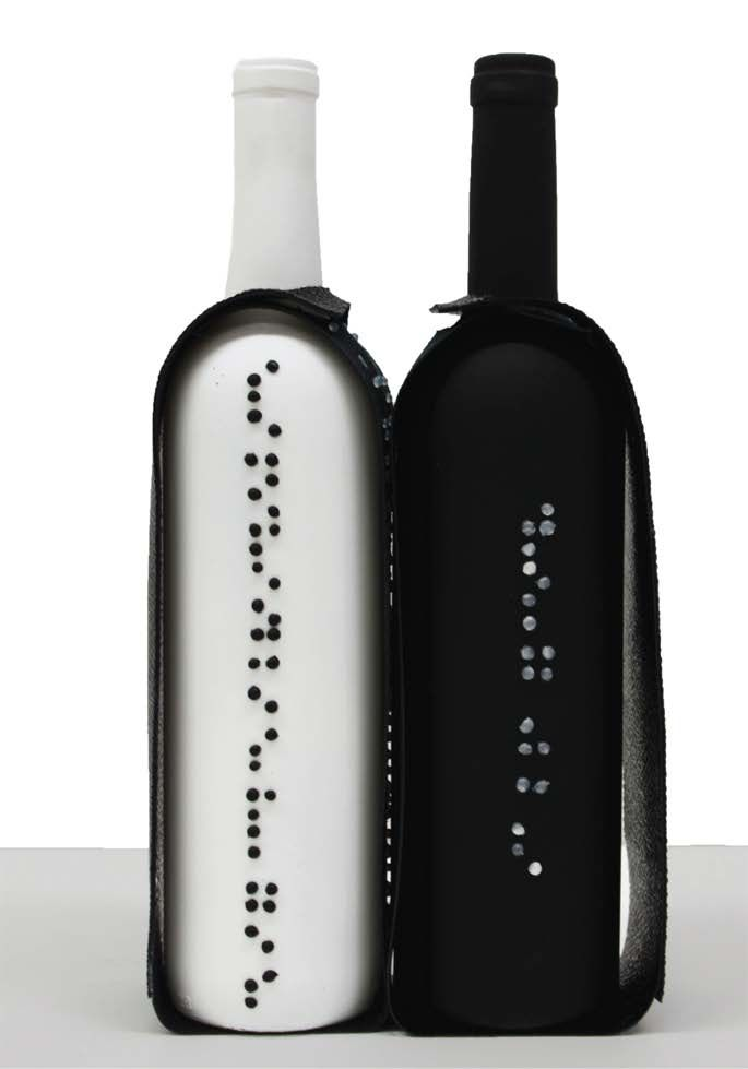 The restaurant O Black has launched the idea of having dinner in the dark to experience a blind person's way of dining, raising awareness, including braille embossed wine botteles. packaging | UQAM | Sylvain Allard