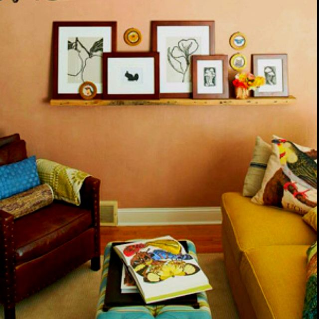 An expansive floating shelf adds character to a blank wall. Layer framed prints or pictures and favorite accessories along the shelf.