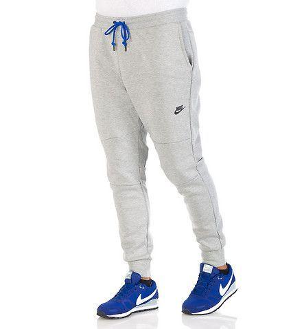 c75416890001 NIKE Athletic sweatpants Elastic waistband closure Adjustable drawstring  for ultimate comfort 2 side pockets 2 zip back pockets Stretch - clothing