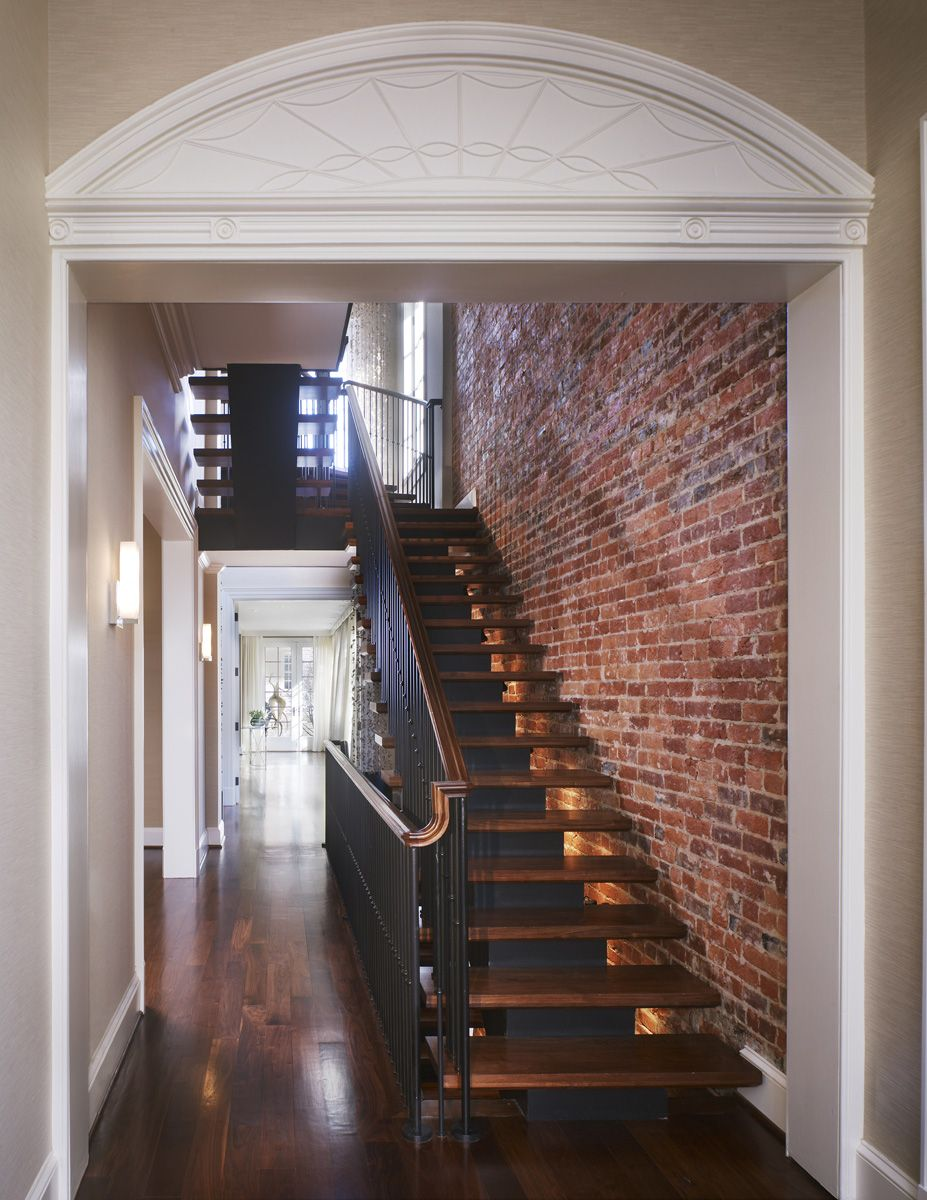 New Steel Staircase With Walnut Risers Against A