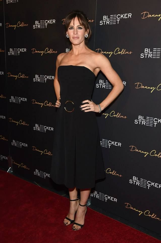 Jennifer Garner wearing our black dry wool tailoring Cami Dress with gold hardware detail from the Stella McCartney Autumn 2015 collection in New York. Photo courtesy of Getty Images.