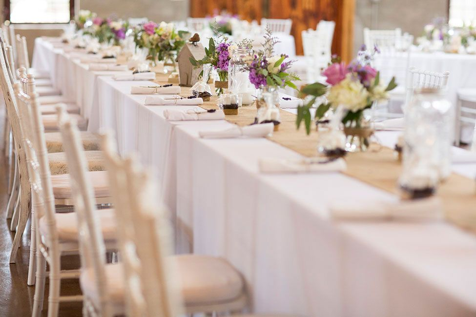 Long reception tables with burlap runner | Lavender Infused Romantic Olde Dobbin Station Texas Wedding | Photograph by The Freckled Key  http://storyboardwedding.com/lavender-romantic-olde-dobbin-station-texas-wedding/