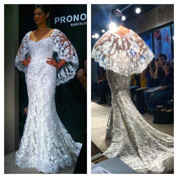 Pronovias cape wedding gown