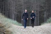 Prince William, Duke of Cambridge and Catherine, Duchess of Cambridge on a visit to Newborough Beach where they met the Menai Bridge Scouts and explored the beach's wildlife habitat, during a visit to North Wales on May 08, 2019 in Anglesey, United Kingdom. #northwales