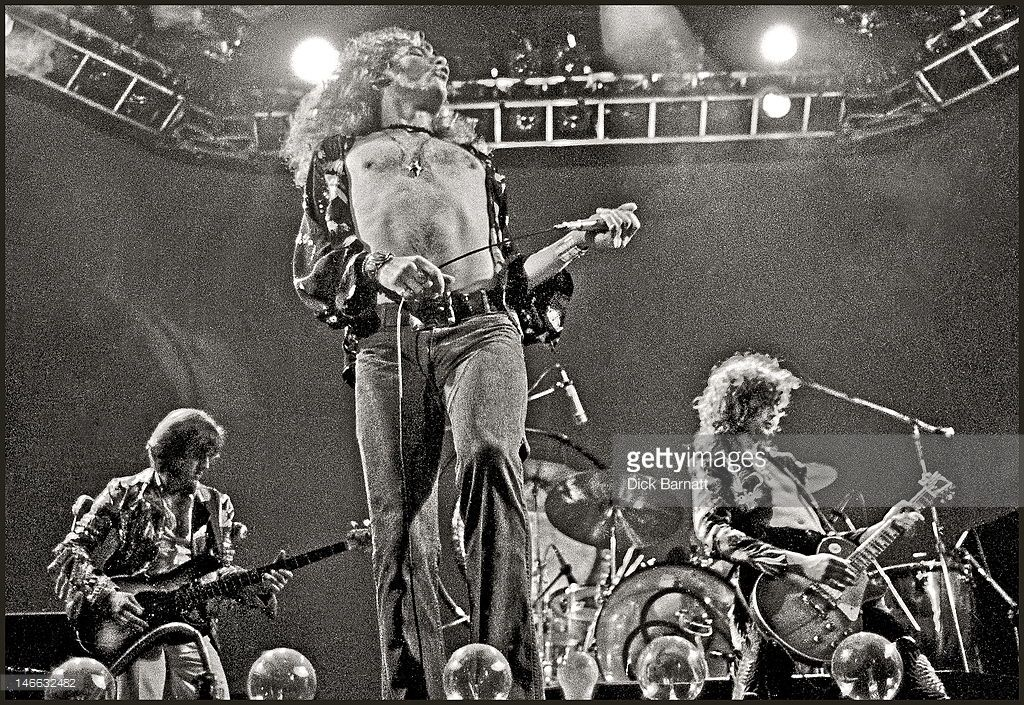 John Paul Jones, Robert Plant and Jimmy Page from rock group Led Zeppelin perform live on stage at Earls Court in London on 24th May 1975.
