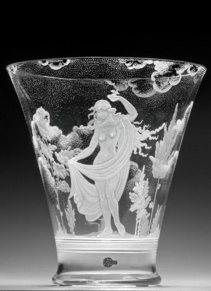Vase with engraved motif of a woman with an apple in his hand. Under the proposal, Ladislav Přenosil it in Železnobrodská glassmaking school performed Jiří Ledvina in 1931