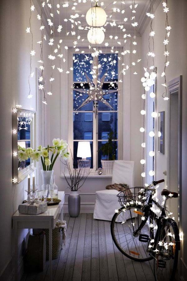 Holidays christmas onekindesign also inspiring ways to decorate your home with string lights in rh pinterest