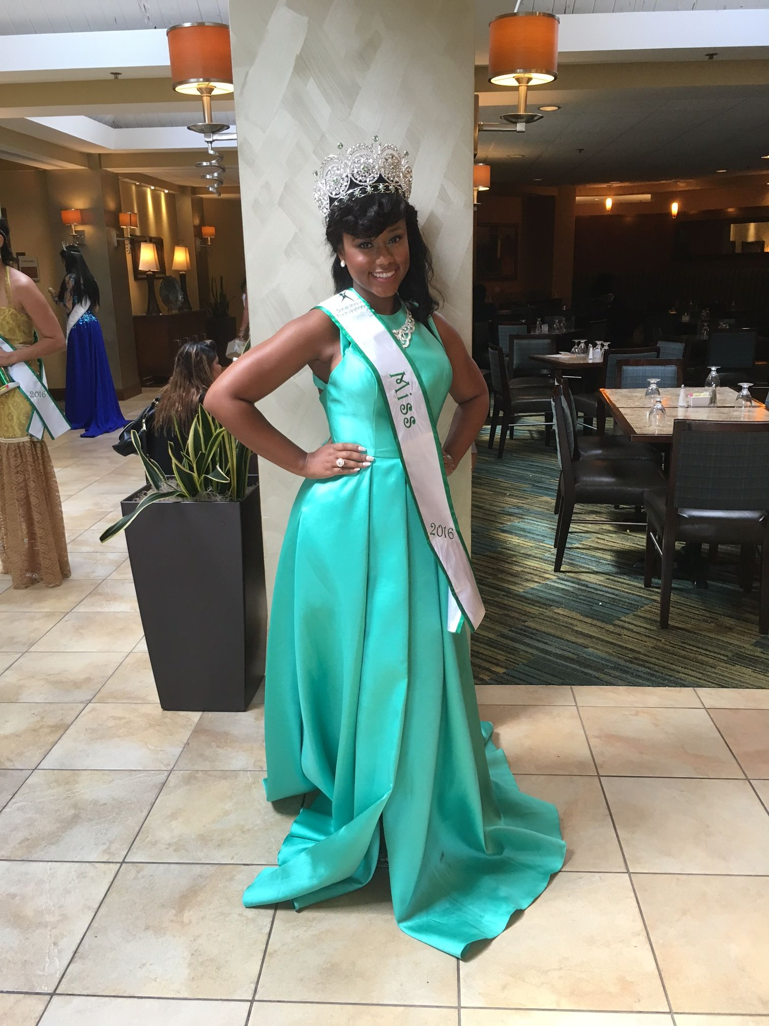 Fan Photo | Kalea seriously rocking our Faviana #7752 Posh Pleated High Low Gown in Spearmint! Rent it for your next event, dance or pageant for only $100!