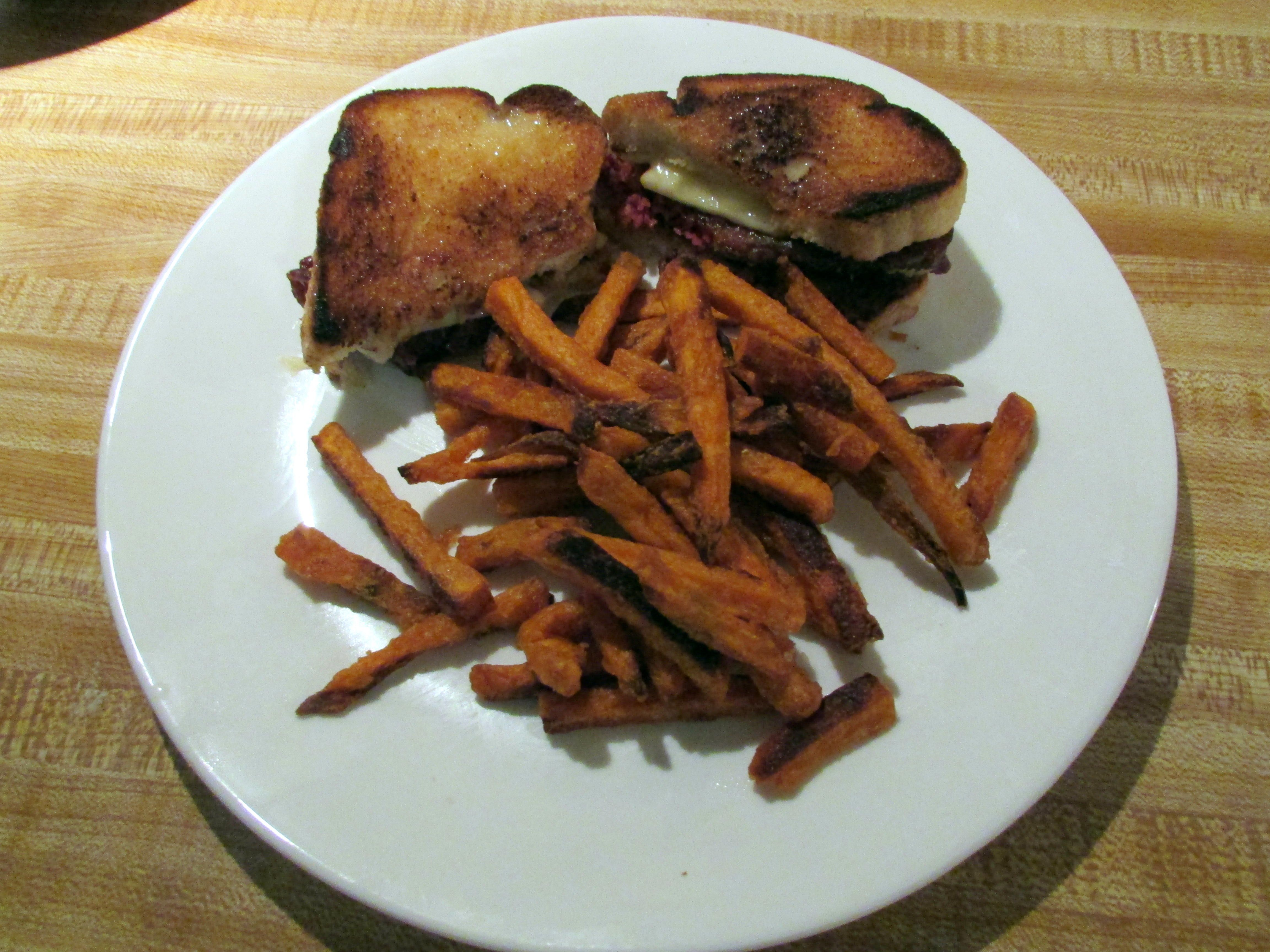 Beef Brisket and sweet potato fries.    Looking through the freezer, I found the beef brisket purchased for St. Patty's day.  Ooops !   Wanting to use it but not with the corned beef seasoning, did a Braised BB pot stew.  The left over beef, I breaded it and fried a nice crust on it and made into BBB sandwiches on Italian Bread toast with cheese.  Along with it some Sweet  potato fries.  Tasty !
