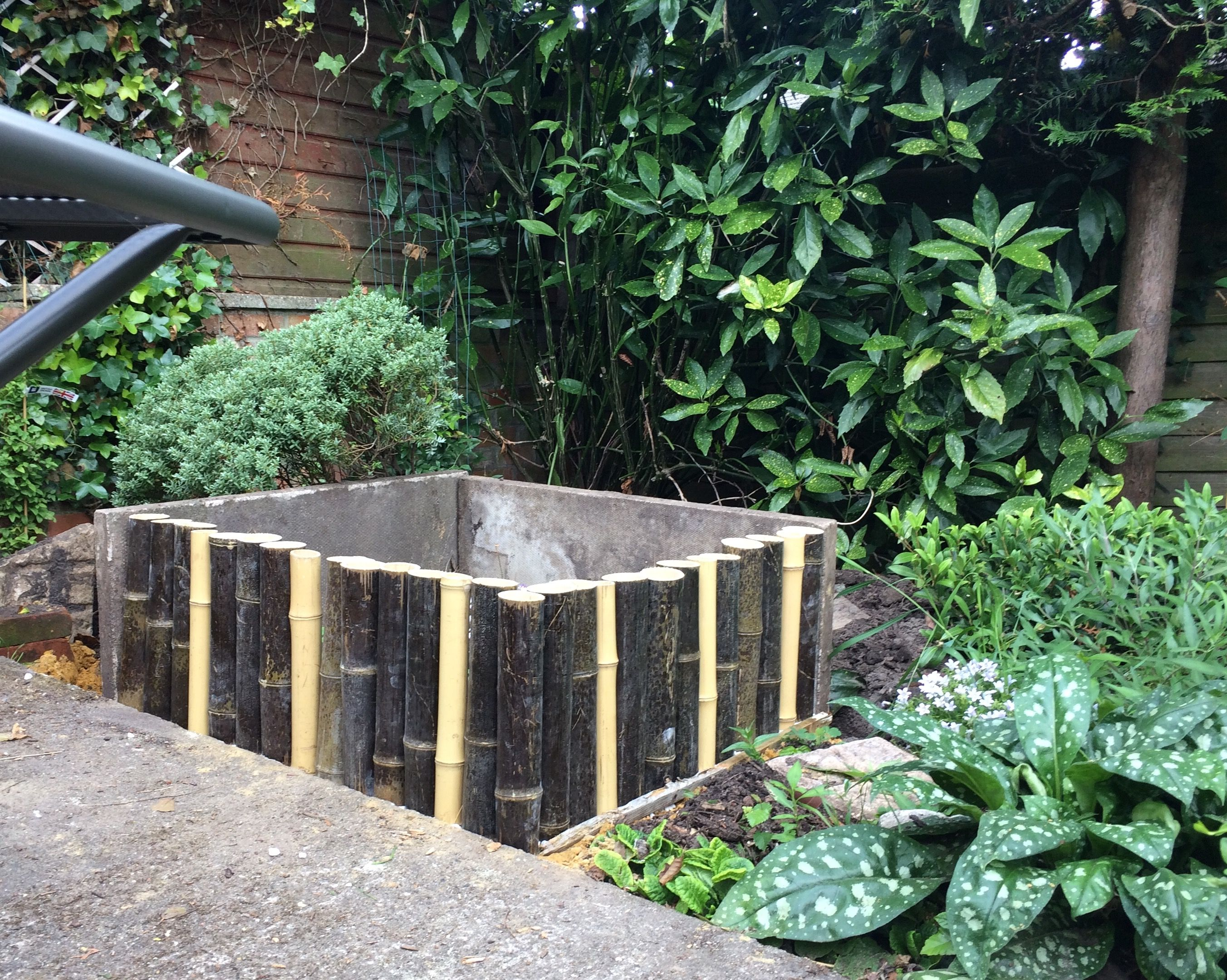 Raised Bed Made From Two Concrete Slabs And Bamboo Poles Sand