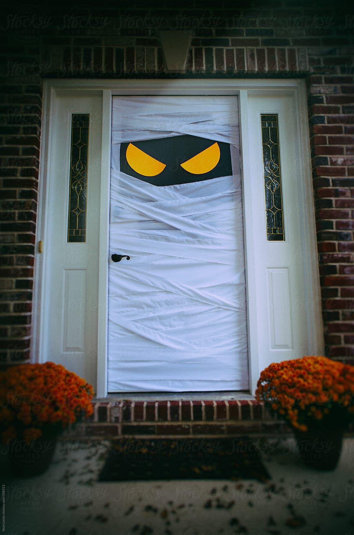 Spooky Halloween Door Dressed As Mummy Stocksy United Halloween Door Decorations Halloween Outdoor Decorations Scary Halloween Decorations