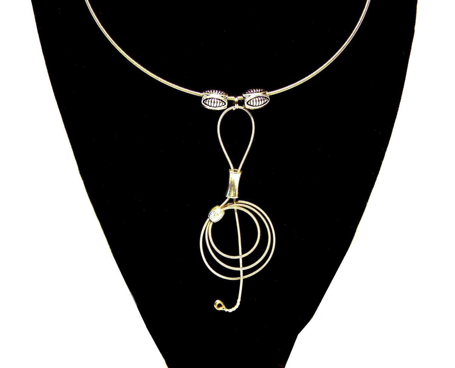 Recycled guitar string jewelry - Recycled Guitar String Treble Clef Choker 32 00 Via Etsy