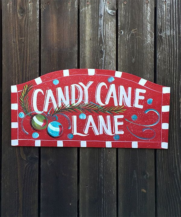 Look at this 'Candy Cane Lane' Hanging Wood Sign on