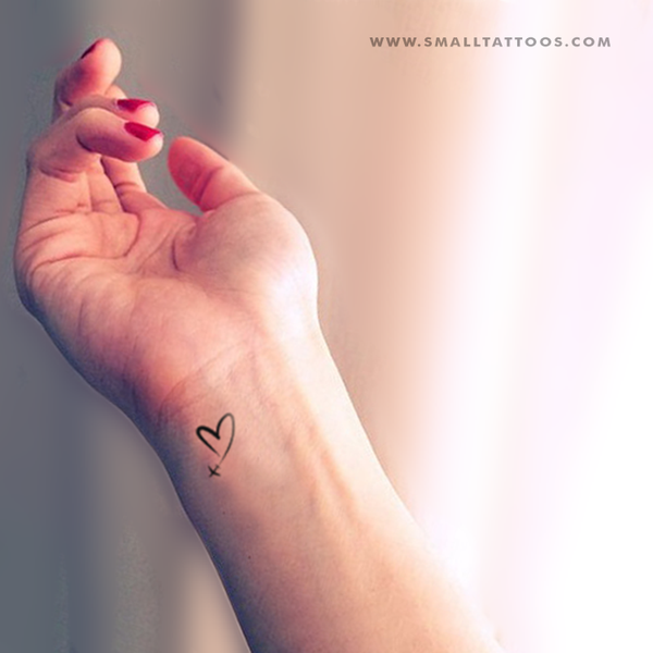 small airplane tattoo with heart