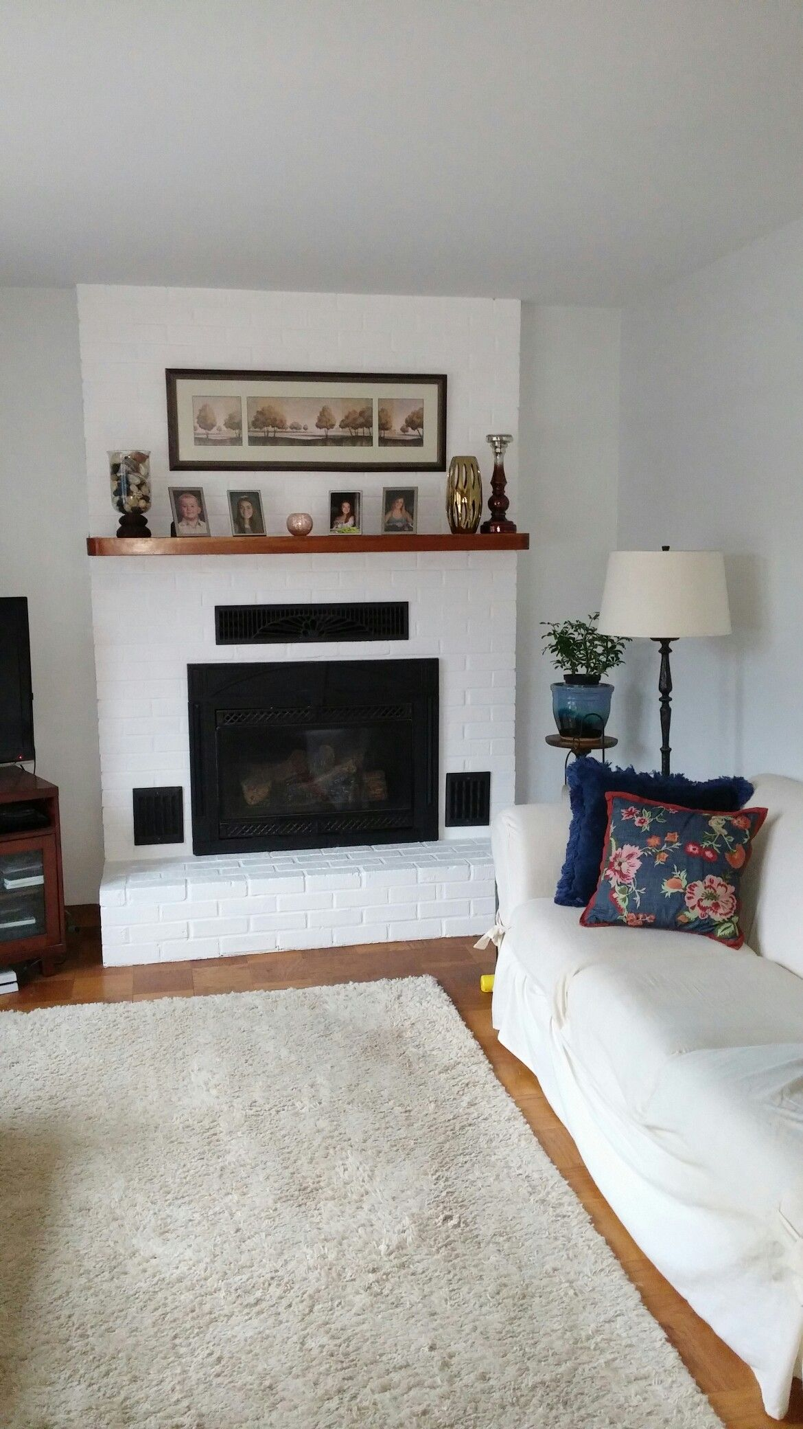 Painted brick fireplace to brighten a room brighten up your room