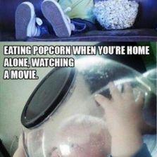 Eating popcorn at home