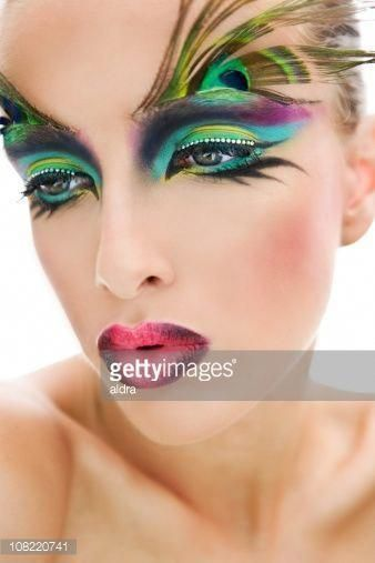 Photo of Young Woman Posing with Peacock Feather Make-Up on Eyebrows #makeupartisticopaso…