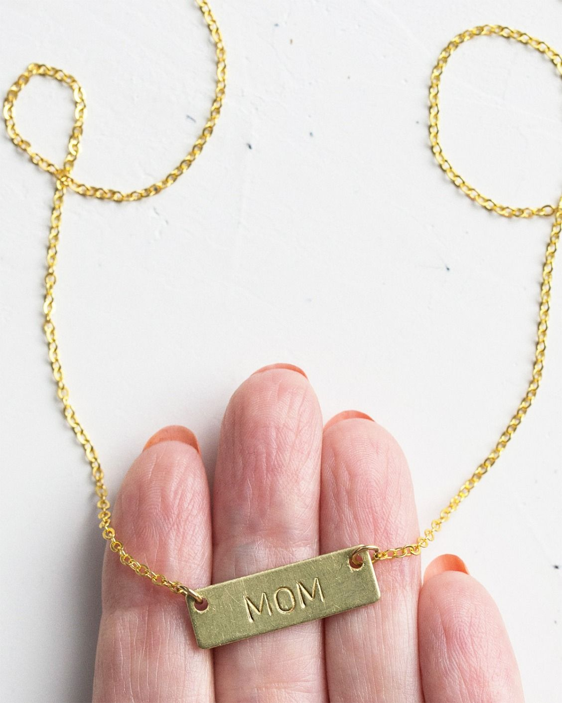 Learn how to make a personalized bar necklace in this metal-stamping tutorial. Craft the perfect gift.