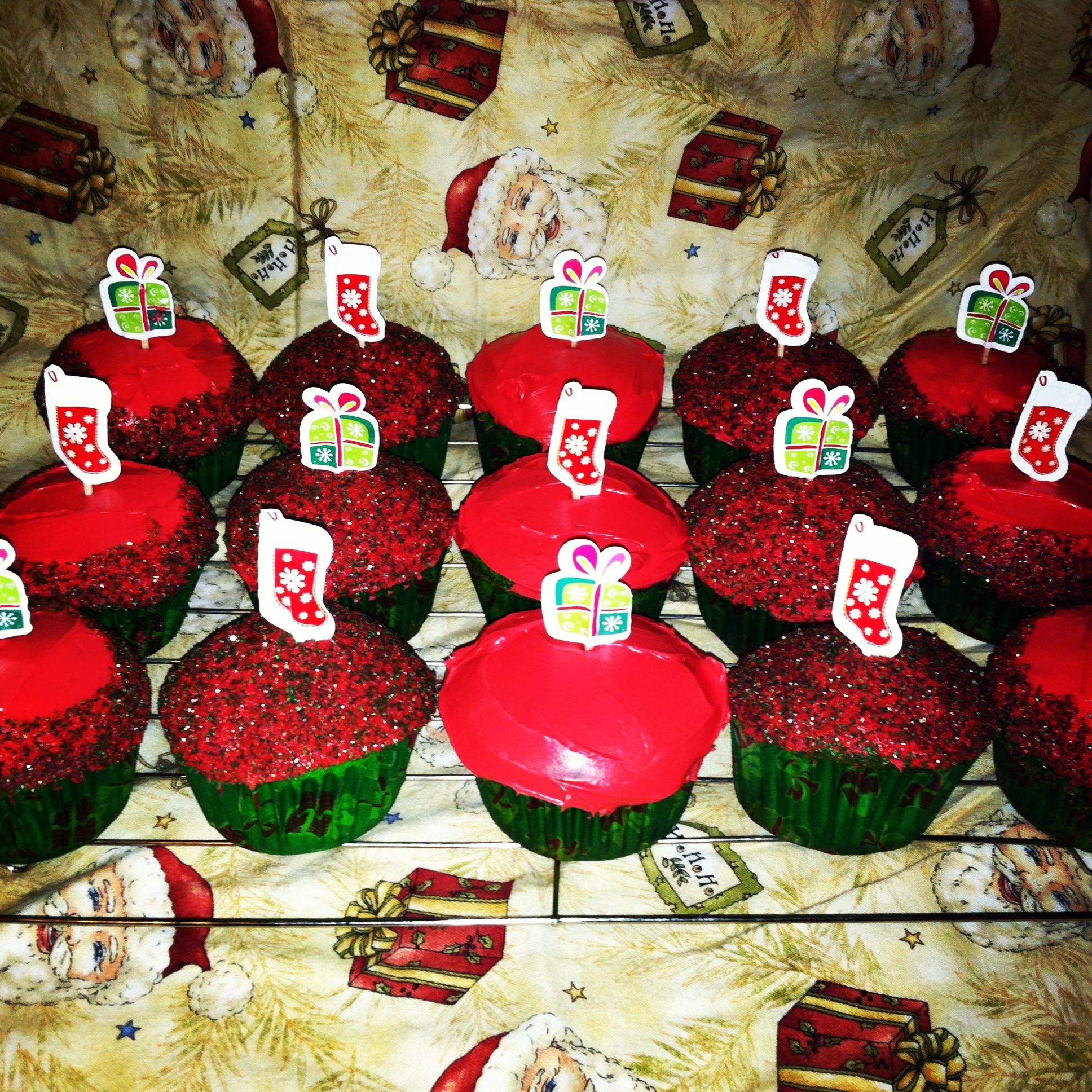 Christmas Cupcakes. (White cake with green food coloring and cream cheese frosting with red food coloring. Picks and liners are from the dollar tree) Have Fun  ❄ MERRY CHRISTMAS  ⛄